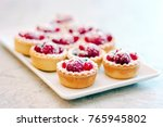 small tarts with berries on... | Shutterstock . vector #765945802