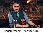 handsome bartender preparing... | Shutterstock . vector #765950686