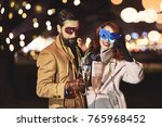 friends with mask and champagne ... | Shutterstock . vector #765968452