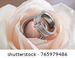 wedding rings inside apricot... | Shutterstock . vector #765979486