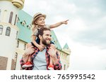 smiling girl pointing away... | Shutterstock . vector #765995542