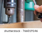 wood is drilled with a drill | Shutterstock . vector #766019146