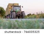 green tractor with trailer ... | Shutterstock . vector #766035325