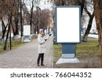 the young woman points to an...   Shutterstock . vector #766044352