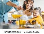 Happy Family At Table  Man...