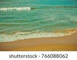 sea waves on the sand beach....   Shutterstock . vector #766088062