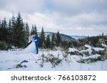 bride and groom in winter snow... | Shutterstock . vector #766103872