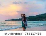 a girl in a dress is walking... | Shutterstock . vector #766117498