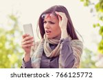 annoyed upset woman in glasses... | Shutterstock . vector #766125772