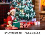 child at christmas tree and... | Shutterstock . vector #766135165