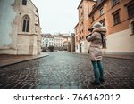 tourist girl is taking photos... | Shutterstock . vector #766162012