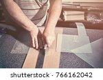 the carpenter in the workshop... | Shutterstock . vector #766162042