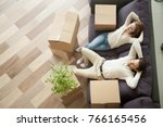 couple resting on couch after... | Shutterstock . vector #766165456