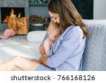 breastfeeding baby. young...   Shutterstock . vector #766168126