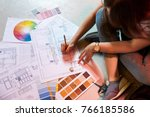 interior designer draws plan... | Shutterstock . vector #766185586