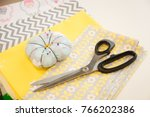 Small photo of Pins and needles in a pin sponge with scissors