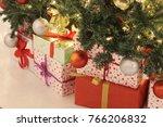 christmas presents under tree | Shutterstock . vector #766206832