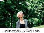 young woman with eyes closed... | Shutterstock . vector #766214236