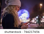 young woman using smart phone... | Shutterstock . vector #766217656