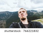 young handsome man taking... | Shutterstock . vector #766221832