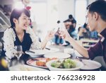 asian young couple enjoying a... | Shutterstock . vector #766236928