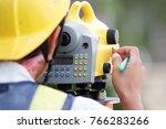 Surveyor Working With Digital...