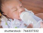 closeup asian newborn baby boy... | Shutterstock . vector #766337332