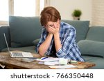 young sad worried and desperate ... | Shutterstock . vector #766350448