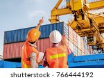 dock worker pointing finger on... | Shutterstock . vector #766444192