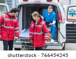 paramedics moving out ambulance ... | Shutterstock . vector #766454245