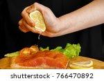 chef squeezes lemon juice on... | Shutterstock . vector #766470892