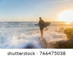 surfer standing on a rock at... | Shutterstock . vector #766475038