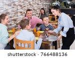 vigorous brunette waitress... | Shutterstock . vector #766488136