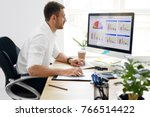 young business man working on... | Shutterstock . vector #766514422