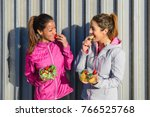 two sporty women on fitness... | Shutterstock . vector #766525768