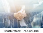 business shake hands showing... | Shutterstock . vector #766528108