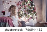 a young woman sits near a...   Shutterstock . vector #766544452