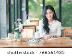 asian girl working in coffee... | Shutterstock . vector #766561435