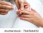 beautician applying red varnish ... | Shutterstock . vector #766566652