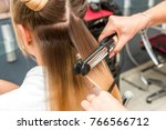 close up of a hairdresser... | Shutterstock . vector #766566712