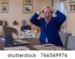 a middle aged red haired man in ... | Shutterstock . vector #766569976