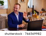 a middle aged red haired man in ... | Shutterstock . vector #766569982