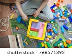a child in gray pants sits on... | Shutterstock . vector #766571392