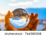 a hand holding a crystal ball... | Shutterstock . vector #766580308