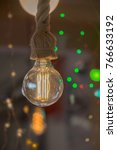 Small photo of Decorative antique edison style filament light bulbs hanging