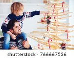 happy family  father and son...   Shutterstock . vector #766667536