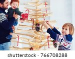 family decorates an... | Shutterstock . vector #766708288
