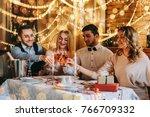 friends celebrating christmas... | Shutterstock . vector #766709332