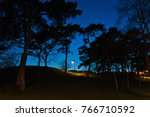 lantern on a walking path at... | Shutterstock . vector #766710592