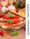 bruschetta bread with basil and ... | Shutterstock . vector #766722952